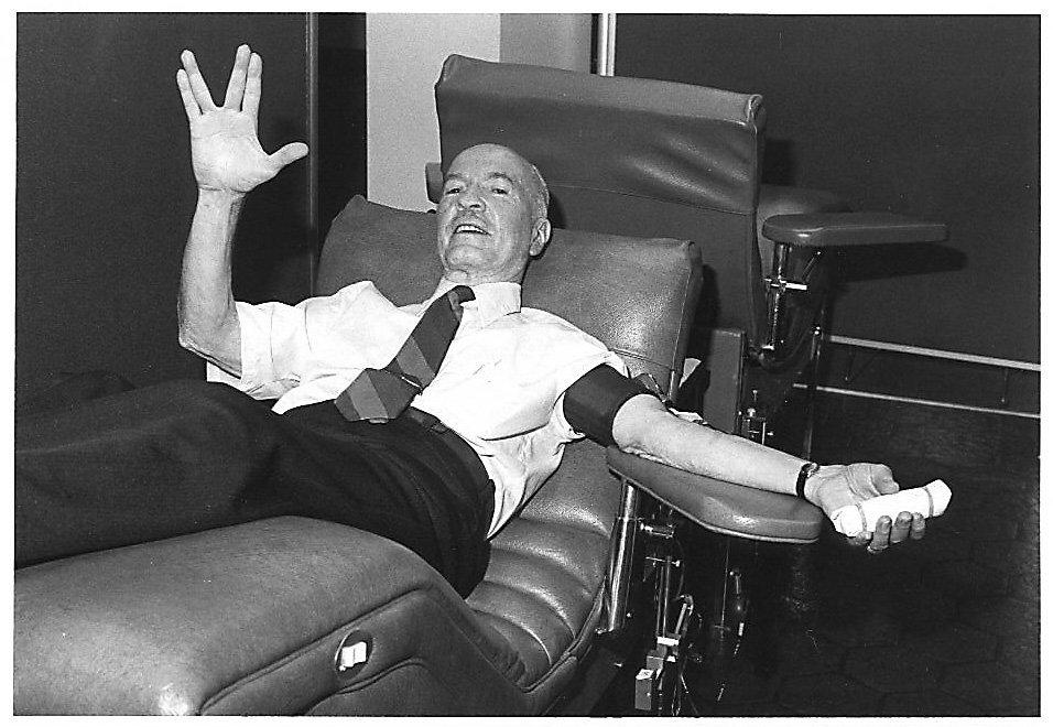 Robert Heinlein giving Star Trek Vulcan salute as he donates blood - print res jpg