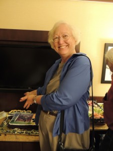 Connie Willis displaying one of the Glory Road cakes