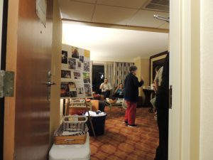 Heinlein Society party room entrance with Heinlein photo display